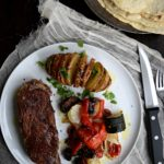 Grilled Beef Ribeye Steaks with Hasselback Potatoes & Roasted Vegetables (featuring ButcherBox)